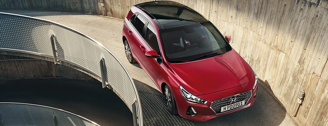 i30 pd 5dr gallery right side front view red uphill road pc